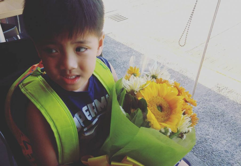 Just bought flowers for his sister
